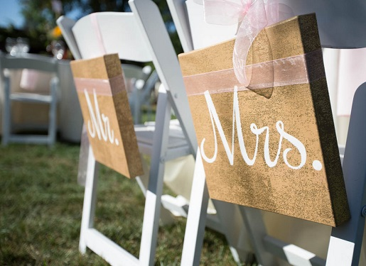 Mr and Mrs wood chair signs for bride and groom