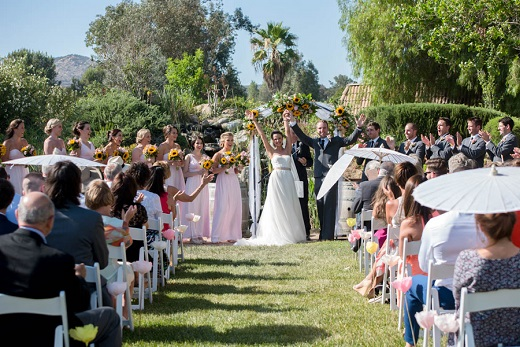 Outdoor wedding ceremony at Bella Gardens with sunflowers