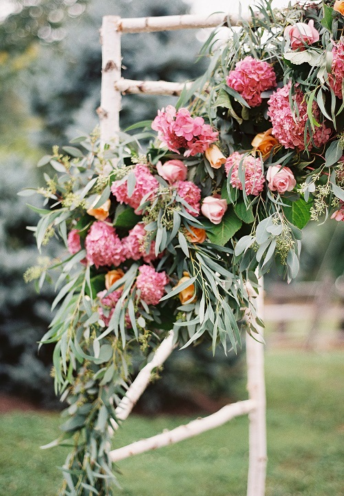 Rustic ceremony alter with colorful folowers and eucalyptus