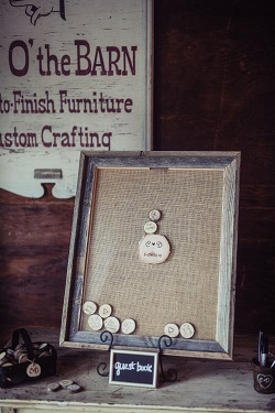 Rustic wedding guests book with little wood slabs and a frame
