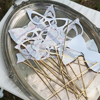 Silver tray of Wedding photobooth accessories created by Avorio paper