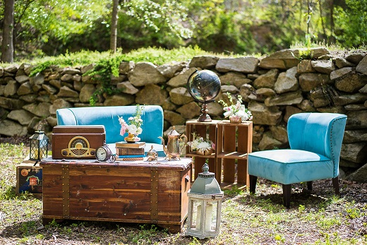 Vintage themed outdoor wedding reception sitting area
