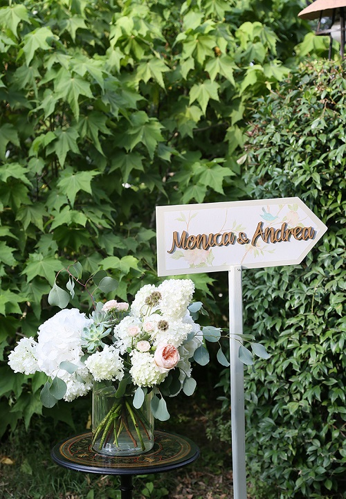 Wedding sign arrow with floral pattern and gold writing
