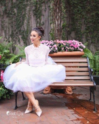 Bride sitting on a bench wearing a clarisa snow white tulle skirt