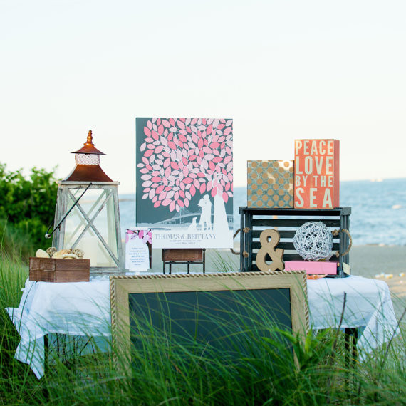 Outdoor wedding with a grey and pink Wedding Guest Book Tree from PaperRamma