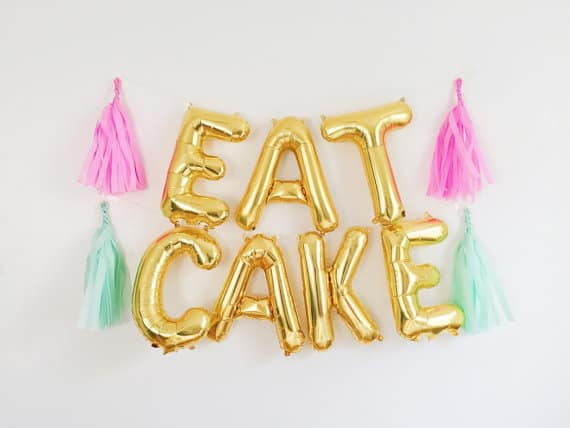 Gold balloons spelling Eat Cake by Oh Shiny Paper Co