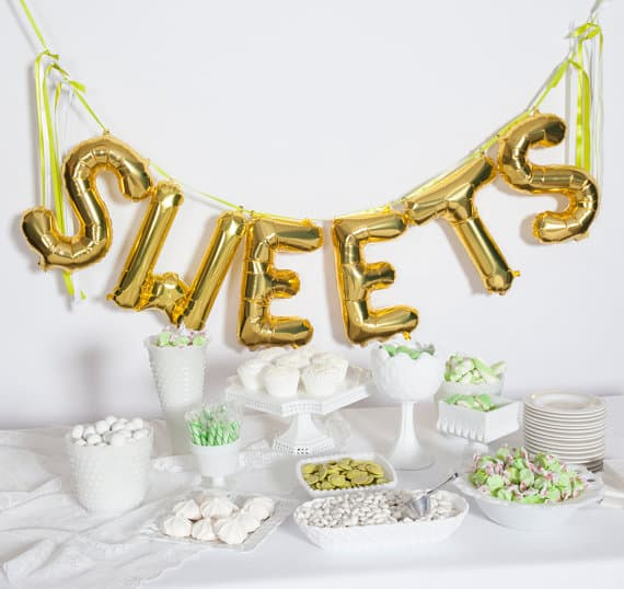 gold balloon spelling SWEET for wedding dessert table