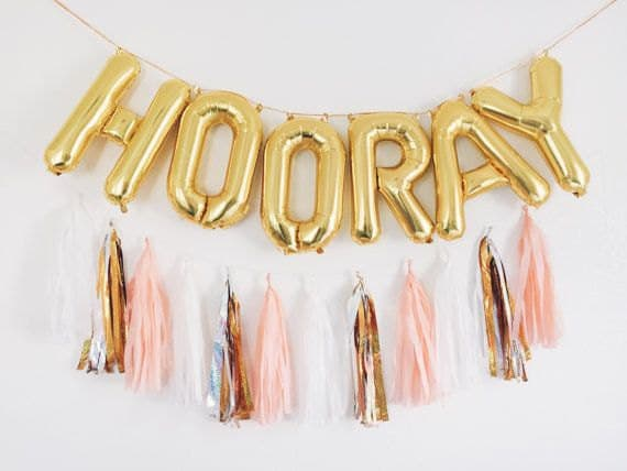 Gild foil balloons spelling out HOORAY