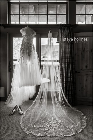 36_wedding-dress-and-veil-hanging-in-window-black-and-white-1