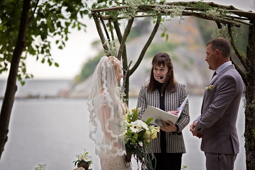 Bride and groom exchange vows during wedding at Whytecliff Park