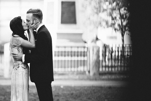 Bride and groom kissing captured by A Brit & A Blonde