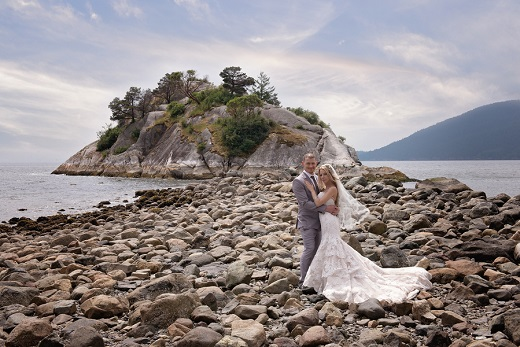 Bride and groom on beach in british columbia captured by Karizma Photography