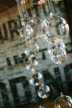 Clear Hanging Glass Terrariums for wedding ceremony decor at The Burroughes Building wedding venue