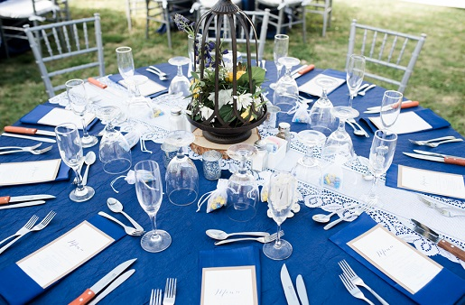 Outdoor wedding reception with bright blue tablecloth