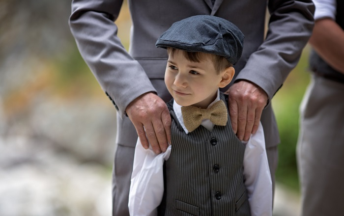 Ring bearer wearing burlap bow tie
