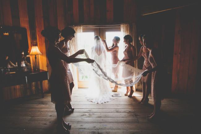 unfurling a lengthy veil