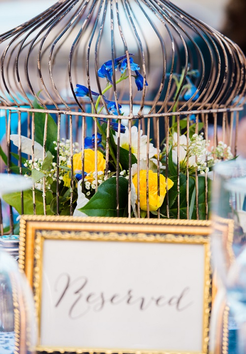 birdcage wedding reception centerpiece with flowers inside