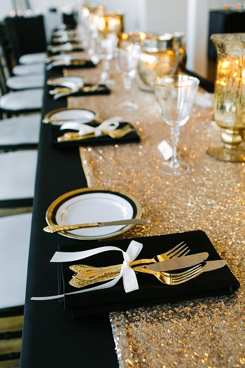 black and gold themed wedding reception table