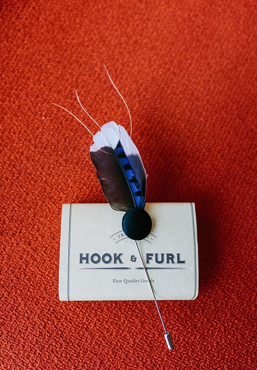 black, blue and white feather boutonniere