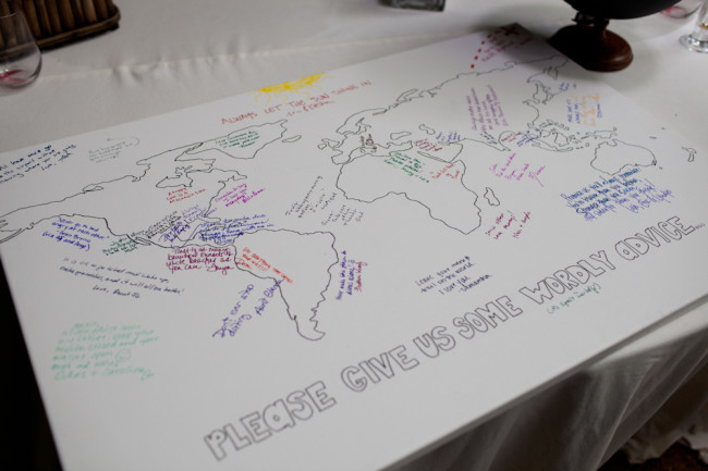 World map wedding guest book asking guest to please give some wordly advice
