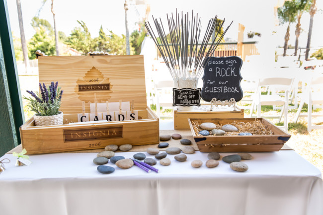table with rocks (or shells) as wedding guest book alternatives