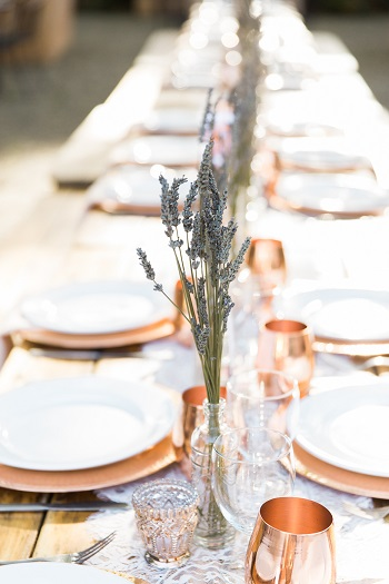Wedding reception with lavender and copper mugs and lace table runner