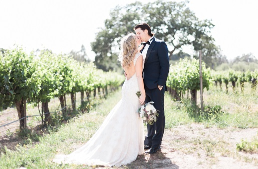 bride and groom first kiss in Brander Vineyards captured by Kaitie Brainerd Photography