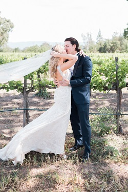 bride and groom kisisng in Brander Vineyards captured by Kaitie Brainerd Photography