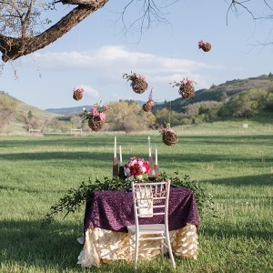purple boho chic styled wedding outdoors