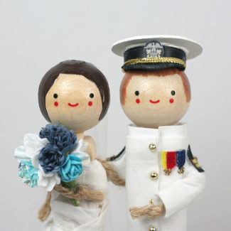 Navy captain themed personalized wedding cake topper