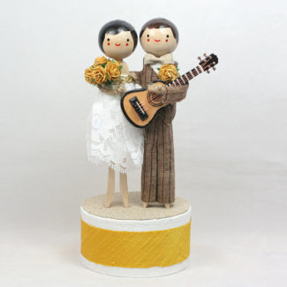 Couple with a guitar personalized wood wedding cake topper