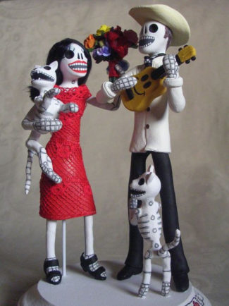 Day of the dead couple with cats and guitar themed wedding cake topper