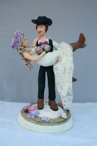 Customized hand sculpted and hand-painted cake toppers with cow boy theme by Crimson Muse