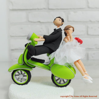 Bride and groom riding on a scooter personalized wedding cake topper