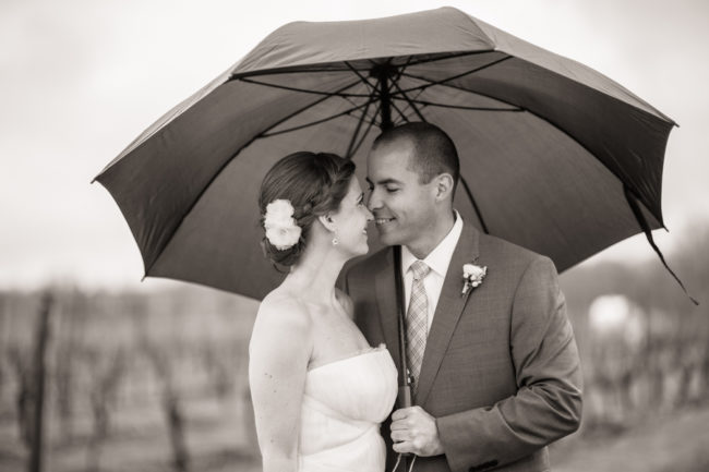 bw photo of couple under umbrella