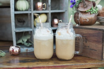 large-mason-jars-with-handle-on-vintage-table