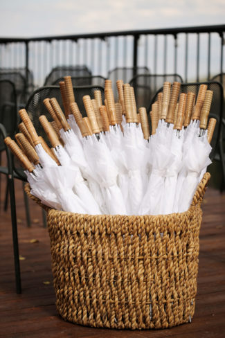 Basket Filled With Wood Handled White Umbrellas