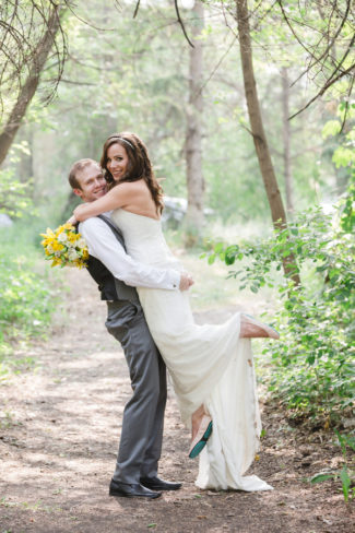 newlyweds embrace with bride wearing Tieks by Gavrieli