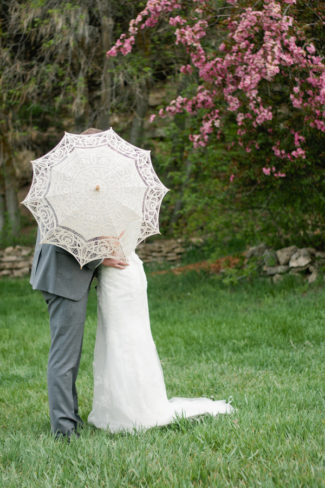 couple hide behind lace parasol