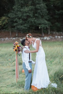 bride-stands-on-pumpkin-and-kisses-groom
