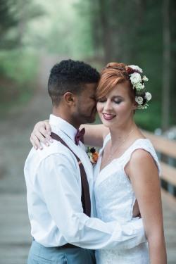 bride-with-flowers-in-hair-and-groom-in-burgundy-suspenders