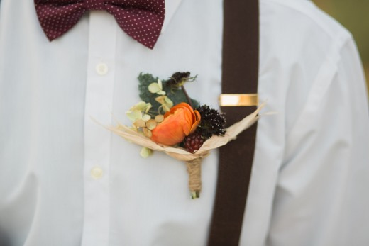 groom-with-orange-flower-boutonniere