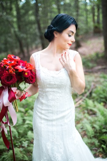 bride-in-white-dress-holding-red-bouquet