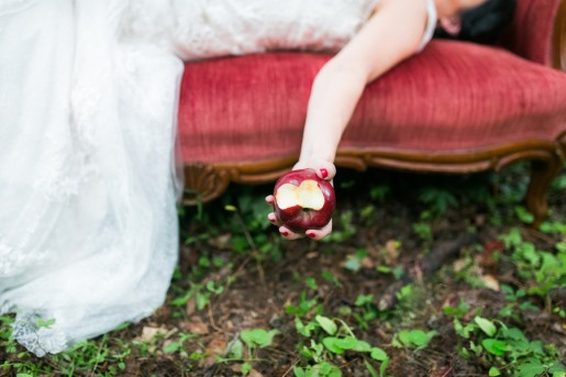 bride-lays-on-sofa-while-holding-bitten-apple