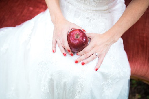 bride-on-sofa-with-red-apple-on-lap