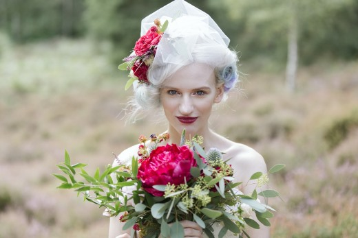 bride-with-red-bouquet-and-birdcage-veil