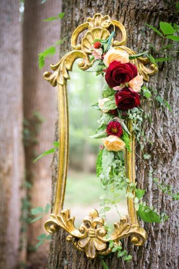 gold-rim-mirror-hung-on-tree