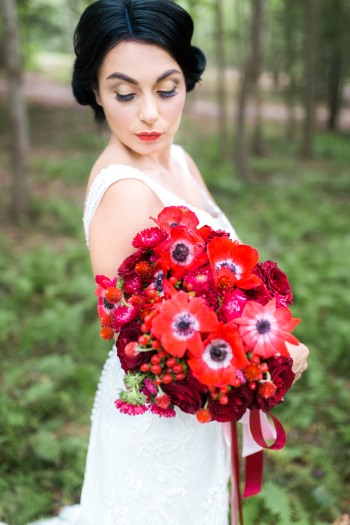 snow-white-bride-with-red-bouquet