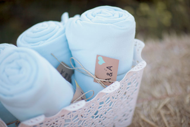 blanket favors in basket for guests at outdoor wedding