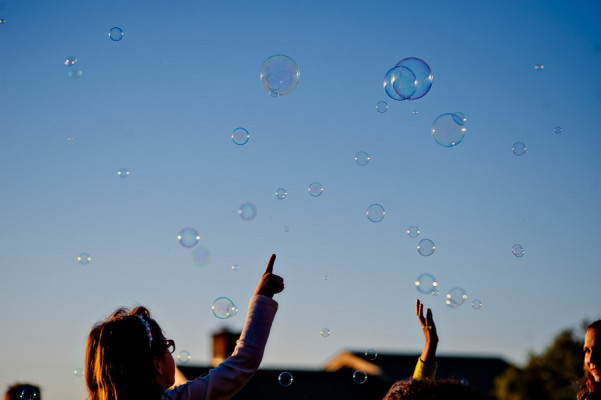 guests-blowing-bubbles-after-outdoor-wedding-ceremony